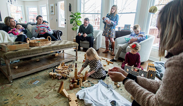Jennie and Kevin Punswick, pictured at far left and in front of window, pray the rosary with family and friends at their home in Overland Park, Kan., Jan. 12, 2020.